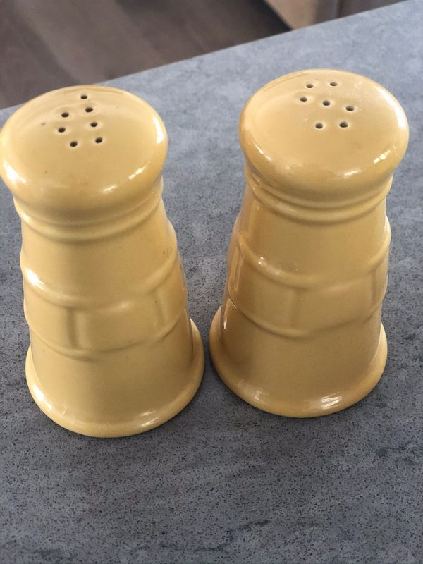 Longaberger cream and sugar dishes as well as matching salt and pepper shakers.