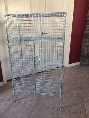 """Bookshelf storage cabinet industrial look / adjustable shelves / all metal / 4ft tall by 26"""" wide by 14"""" deep for Sale in Glendale, AZ"""