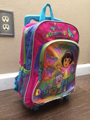 Dora Backpack w/ Handle Extension & Wheels.. normal wear on bottom front for Sale in Upland, CA