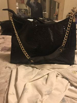 Redkin black purse with gold hardware and tassle for Sale in University City, MO
