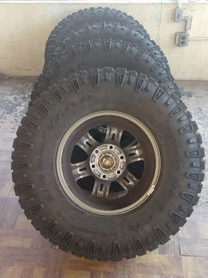 These are 4 like brand new goodyear Wrangler tires. They come with the the lugnuts and the spacers for this setup w/ rims. They are 285/ 75R 16. for Sale in Glen Burnie, MD