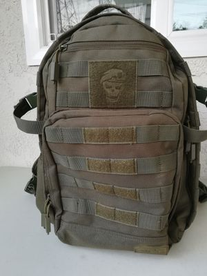 Used SOG Ninja Tactical Day Pack, 24.2 L with One Tigris Drawstring Water Bottle Holder for Sale in Lakewood, CA