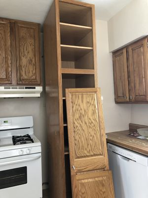 Tall Oak kitchen cabinet for Sale in St. Louis, MO