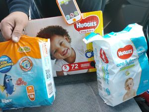 Huggies little swimmers 18pk size med....1 72 count size 5 box of buggies...and 1 bag of 184 count baby wipes for Sale in Colorado Springs, CO