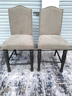 Set of 2 taupe upholstered bar chairs with nailheads for Sale in San Diego,  CA