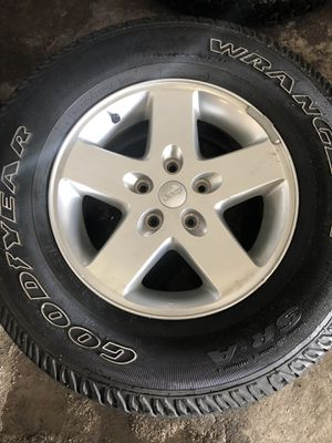 2015 Jeep Wrangler OEM Wheels and tires set of 5. for Sale in Tampa, FL