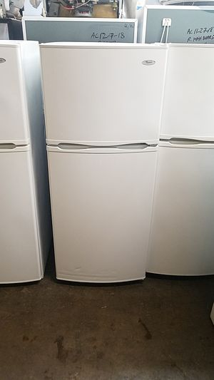 Whirlpool 24 in wide refrigerator top freezer frost-free glass shelves White for Sale in Portland, OR