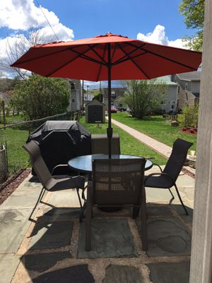 Outdoor Table. 4 Chairs. Umbrella with stand and cover. excellent condition. Umbrella is like new. for Sale in Sunbury, PA
