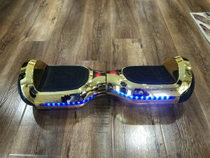 "7"" Bluetooth gold color hoverboard with LED lights for Sale in Ontario, CA"