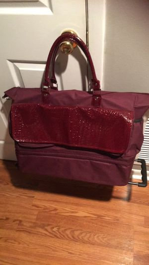 Purple rolling carryon bag 15x21x7 for Sale in Orlando, FL