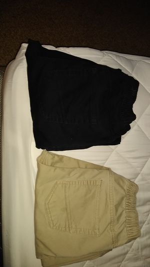 Brown khaki uniform size 14/16 black uniform pants 14/16 for Sale in San Antonio, TX