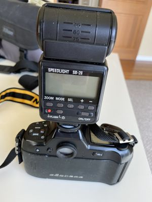 Nikon F90X film camera with lenses and accessories for Sale in Seattle, WA