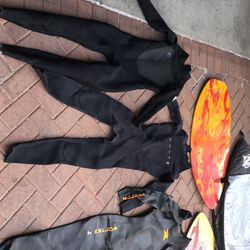 (NOT FREE)a ton of wetsuits skimboards bags and fins for Sale in Irvine,  CA