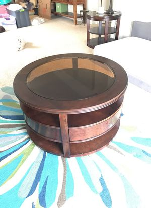 Jeromes solid wood and glass coffee table 3 shelves two drawers for Sale in San Diego, CA