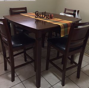 Tall dining table set four chairs kitchen table for Sale in Fresno, CA