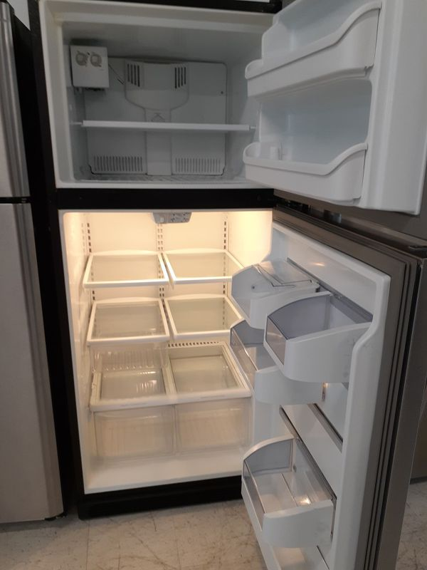 Frigidaire stainless steel top freezer refrigerator used good condition with 90 day's warranty