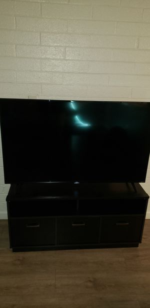 Roku 55 inch TV with TV stand for Sale in Phoenix, AZ