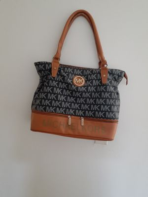 Michael Kors woman hand bag in good condition. for Sale in Orlando, FL