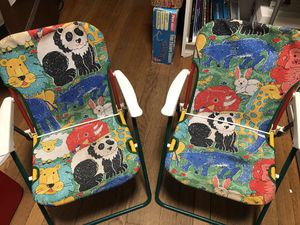 Kids table and 2 chairs with animal design for Sale in Washington, DC