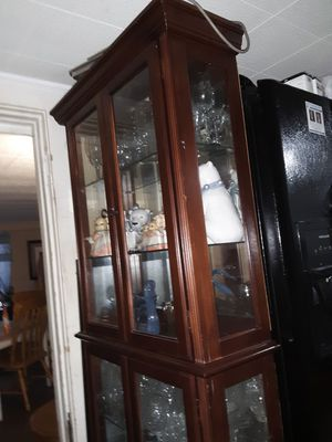 Like new curio has lights solid wood. for Sale in Laurel, MS