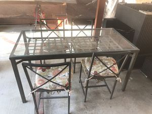 Metal patio steel and glass table with 4 chairs for Sale in Bell Gardens, CA