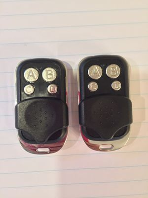NEW: Pair of garage door opener remote controls keychain fobs- Genie compatible for Sale in Westborough, MA