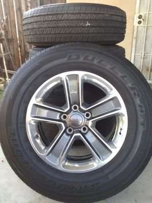 Jeep Rims with Bridgestone Dueler Tires for Sale in Rialto, CA