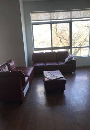 red leather couch 2 piece set with foot stand for Sale in Windsor, ON