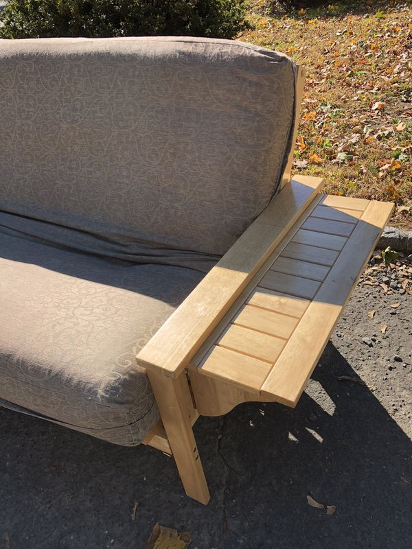 Futon with pull out side tables