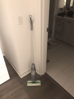 Swiffer with vacuum, comes with sheets for Sale in Chicago, IL