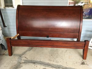 King sleigh style bed frame. In good condition has wood headboard and foot board and metal side rails. Also has support slats for Sale in Jacksonville, FL