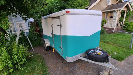 Camper cargo utility enclosed trailer solar 12ft for Sale in Puyallup,  WA
