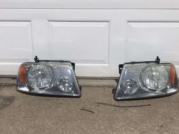 2007 Ford F-150 stock headlights and grille.