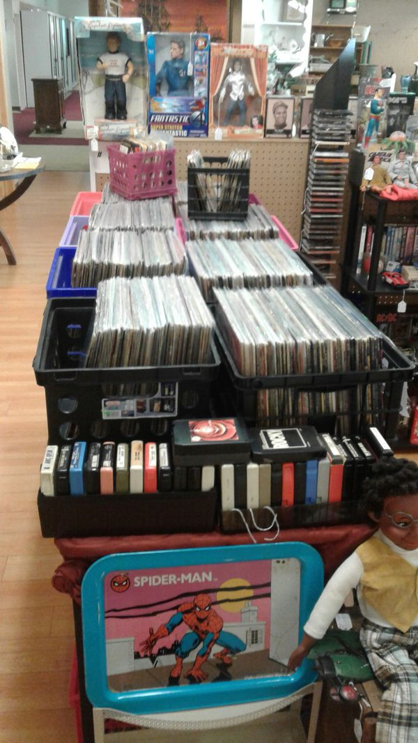 Records and collectable glasses cds and cassette tapes books toy