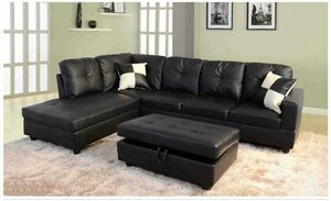 Black leather sectional with ottoman has storage ( new ) for Sale in Hayward, CA