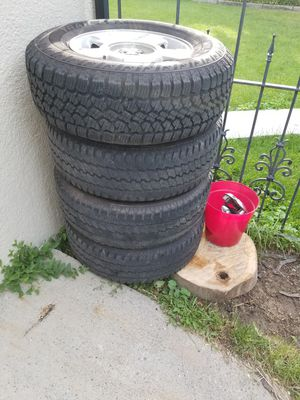 Rims and tires 6 bolt pattern came off a 2011 Ford f150 comes with center caps 5 tires total size of tire in pic for Sale in Billings, MT