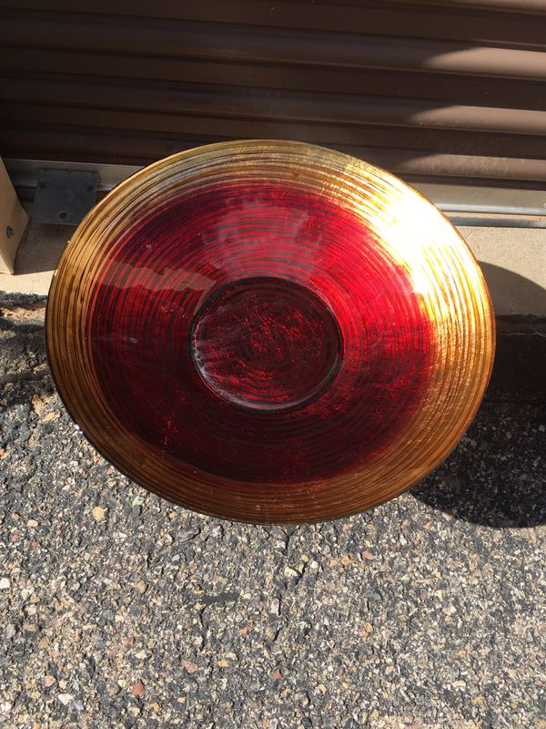 Bird Bath or hummingbird Feeder. Red and gold glass dish with copper base