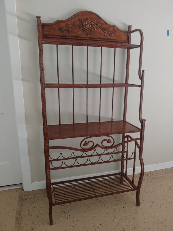 Bakers rack/ wine rack,solid grape wood carvings in good condition.