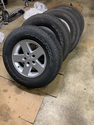 Jeep Wrangler wheels and tires. for Sale in Puyallup, WA