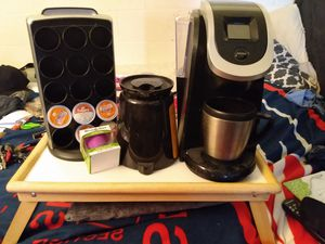 kurig coffee maker along with drink cup holder, karaf , drink cup ,and self brew cup for Sale in Aiea, HI