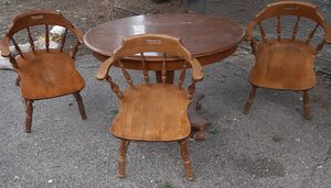 4 chairs and dining table... fourth chair not shown in the picture because two cracks in the seat and needs to be glued. Asking $100. for Sale in Big Rapids, MI