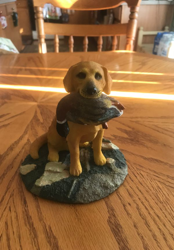 Hunting Yellow Labrador Retriever Dog With Duck In Mouth