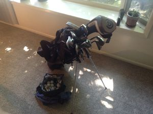 Complete golf set - 2 thru PW, L, S and 3 putters. With extra S and L. Bag has self stand and blackstrap plus several balls. for Sale in Portland, OR