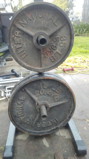 Olympic milled made in Canada International weights 2-45/35lb for Sale in Stockton, CA