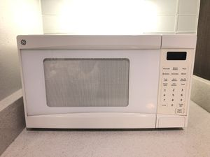 General Electric white microwave for Sale in Austin, TX