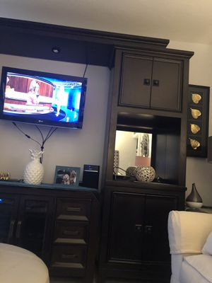 WALL UNIT ENTERTAINMENT/TV WITH BACK MIRROR,LIGHTS, SHELVE LOTS OF STORAGE FOR DVD IN MINT CONDITION DARK CHOCOLATE CONTEMPORARY LIKE NEW REAL WOOD for Sale in Miami, FL