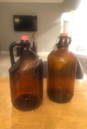 2 antuque 1/2 gallon amber glass Clorox bottles. for Sale in Canton, GA