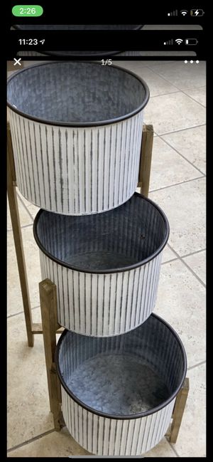 Brand new metal, new in box wood 3 tier plant stand! Width of pot 11 inches and height of pot is 8 inches $55, great for indoors and outdoors! for Sale in Bridgeview, IL