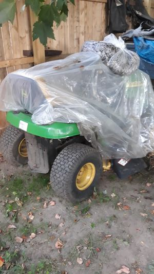 John Deere riding lawn mower needs a starter or four parts for Sale in Chicopee, MA