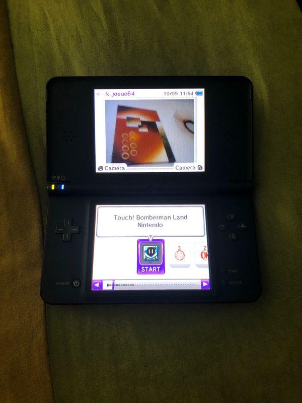 Nintendo DSI XL with games.